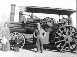 Photo of Kelpe in front of farm equipment