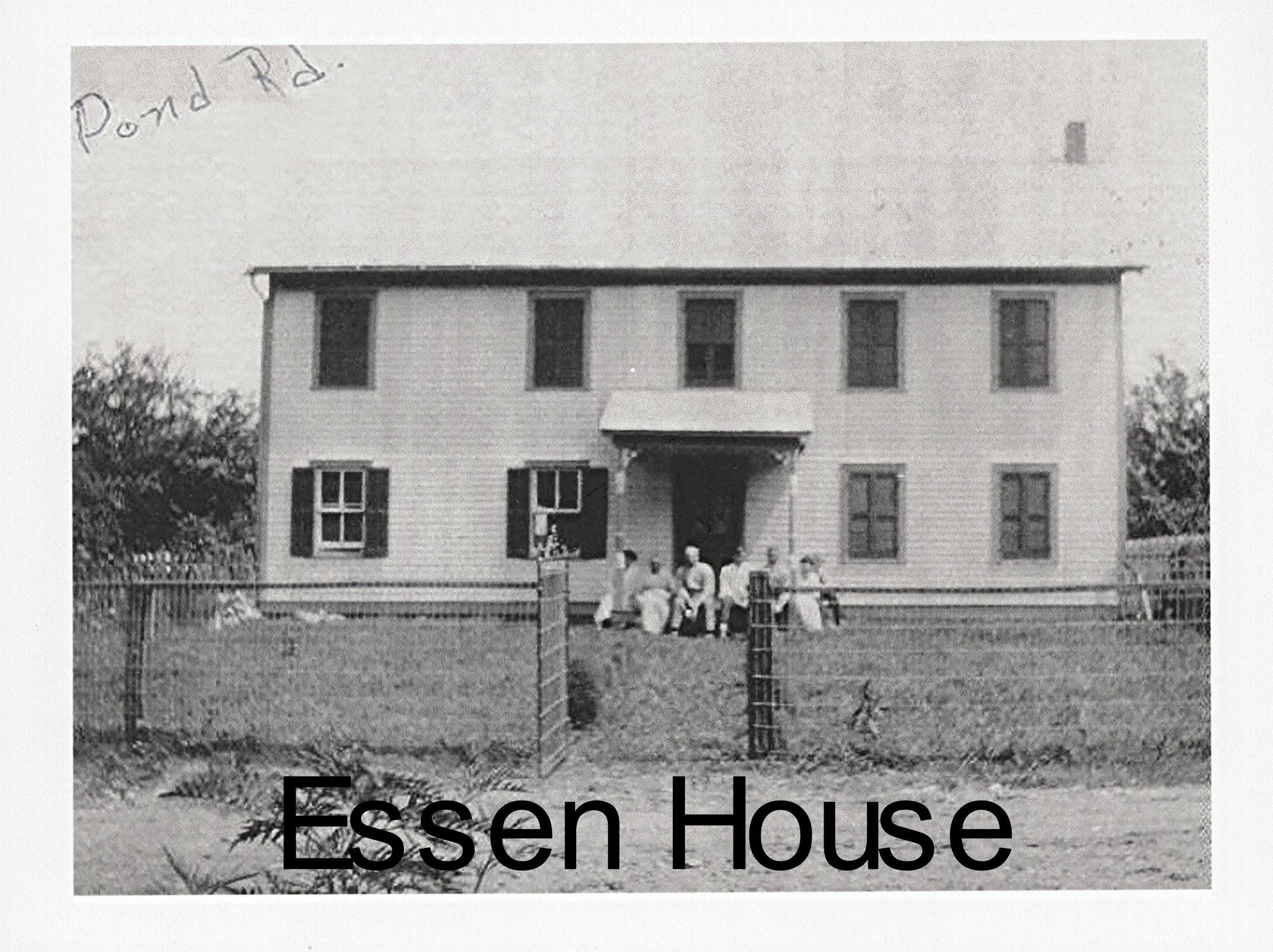 Photo of the Essen House and family sitting on the porch